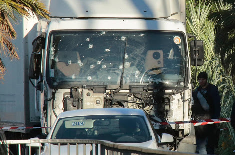NICE, FRANCE - JULY 15: Forensic police investigate a truck at the scene of a terror attack on the Promenade des Anglais on July 15, 2016 in Nice, France. A French-Tunisian attacker killed 84 people as he drove a truck through crowds, gathered to watch a firework display during Bastille Day celebrations. The attacker then opened fire on people in the crowd before being shot dead by police. (Photo by Patrick Aventurier/Getty Images)